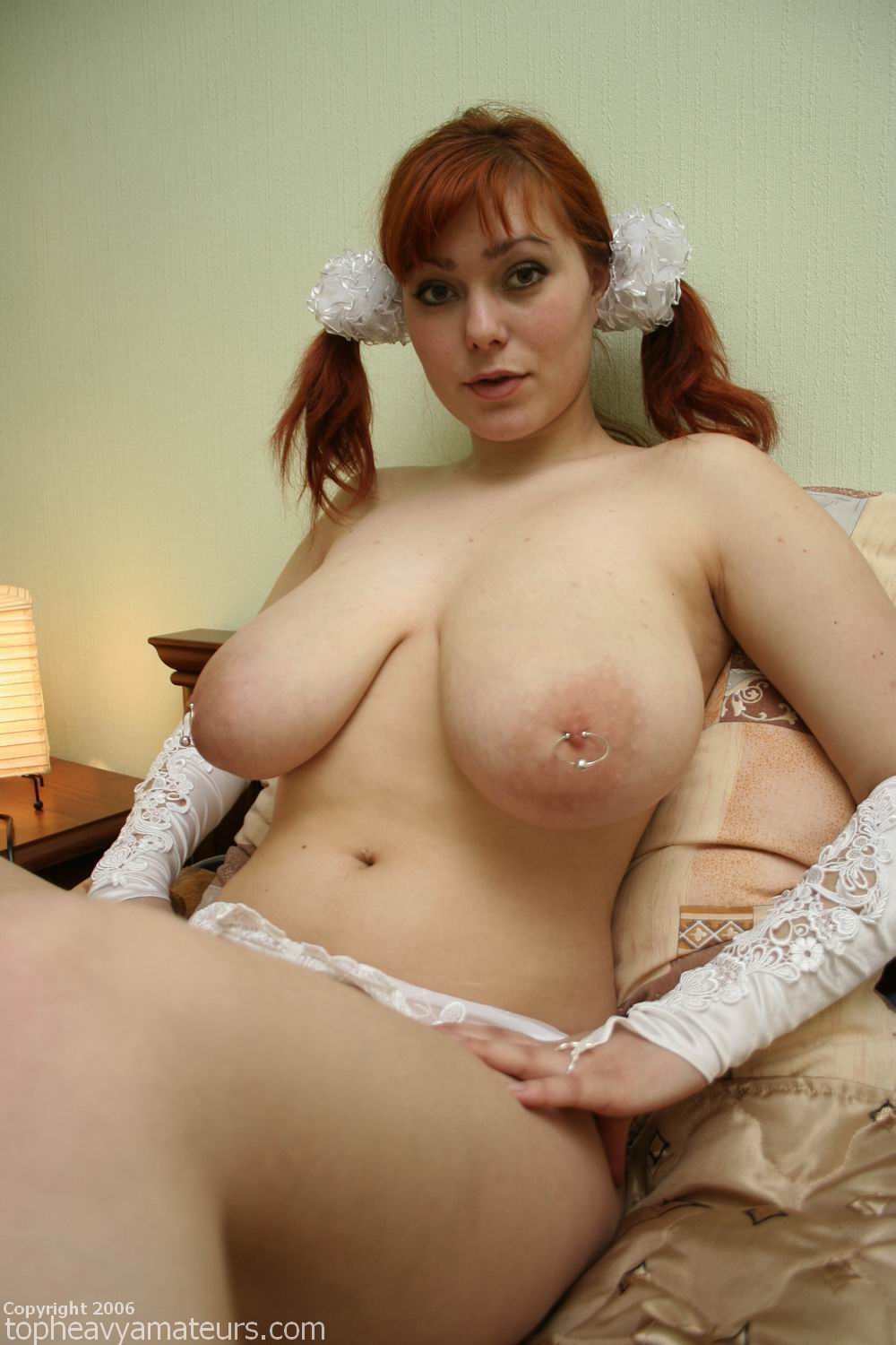 image Redhead with a nice rack used as an example to explain about bdsm